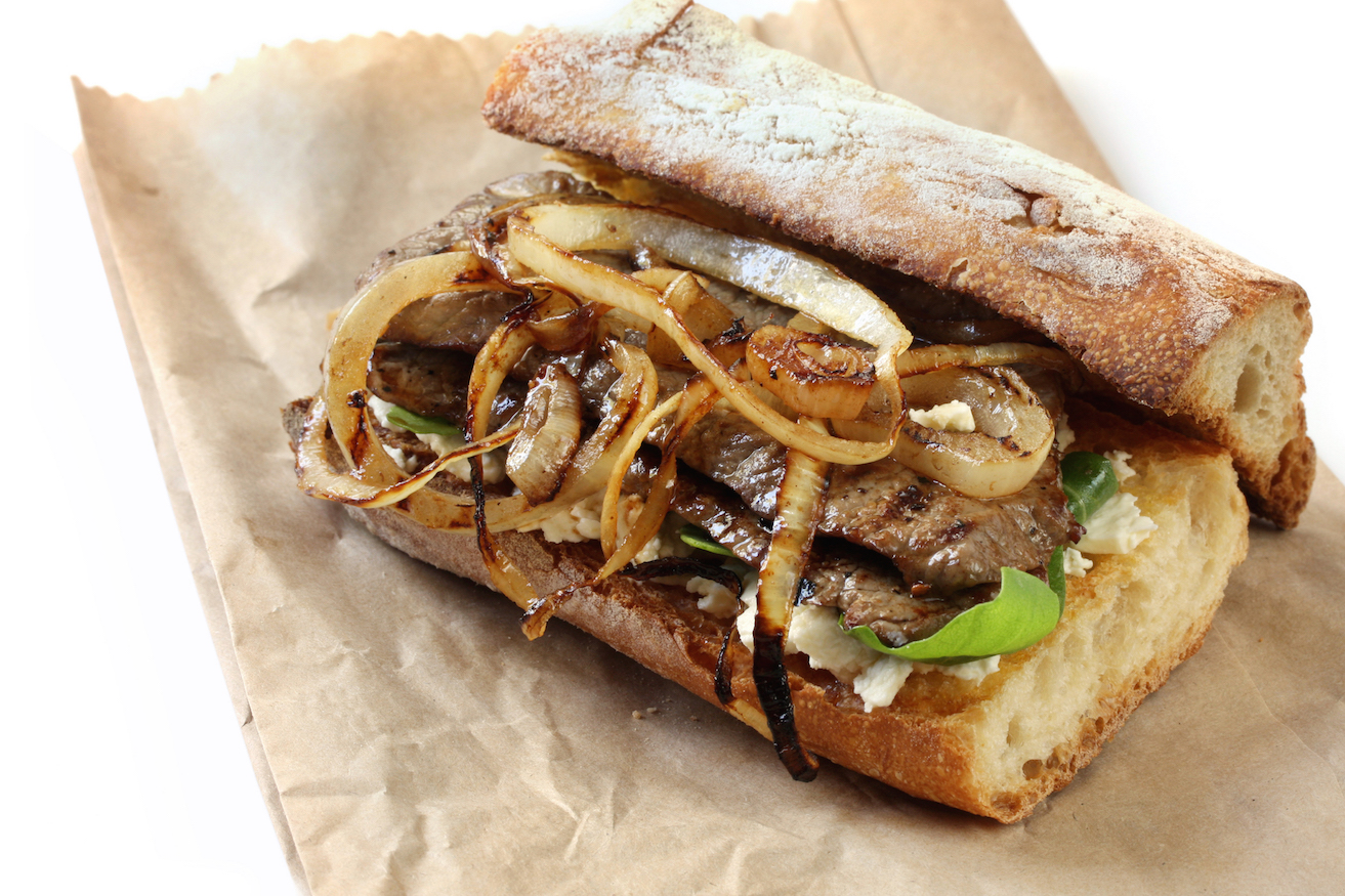 Steak sandwich - toasted baguette with grilled beef and onions, on ...