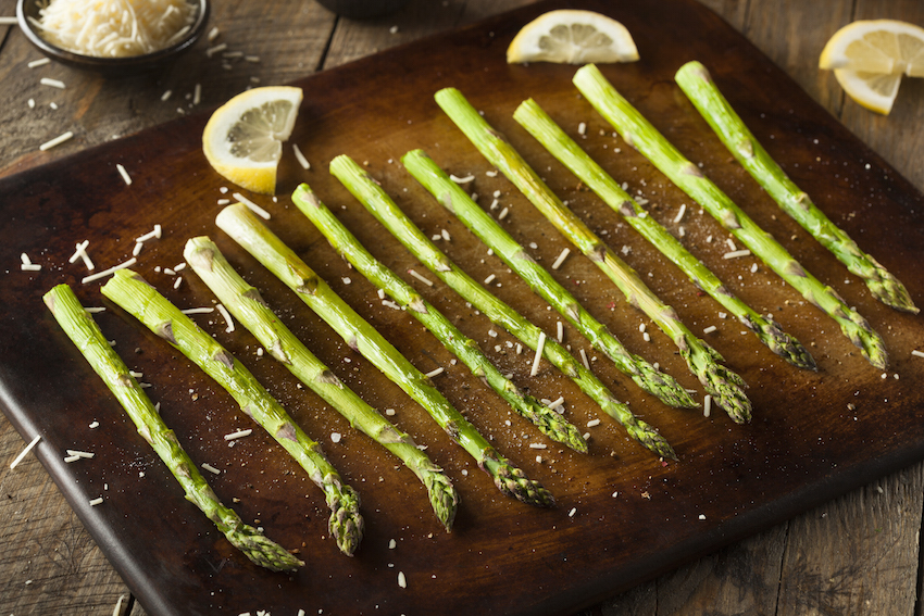 Homemade Cooked Green Asparagus with Lemon and Cheese