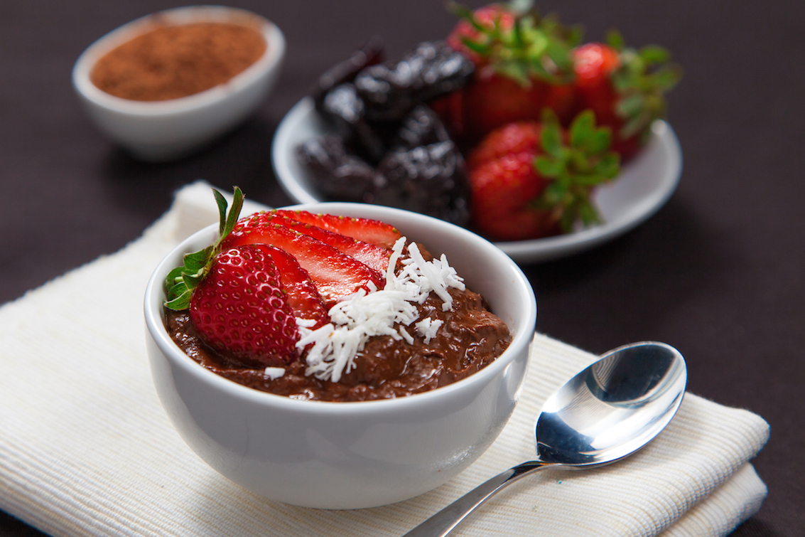 Raw cacao and avocado mousse with coconut and strawberries