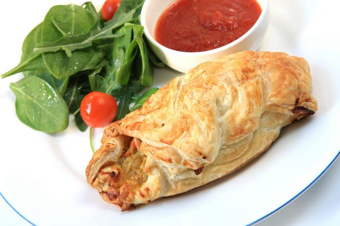 Cornish pasty and salad, with a chili dipping sauce.  A modern variation on this traditional Cornish miners' vegetable pie.