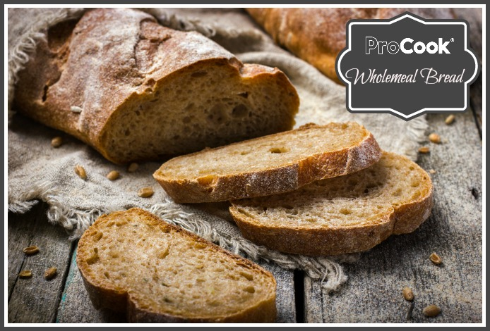 fresh homemade whole wheat bread on rustic background