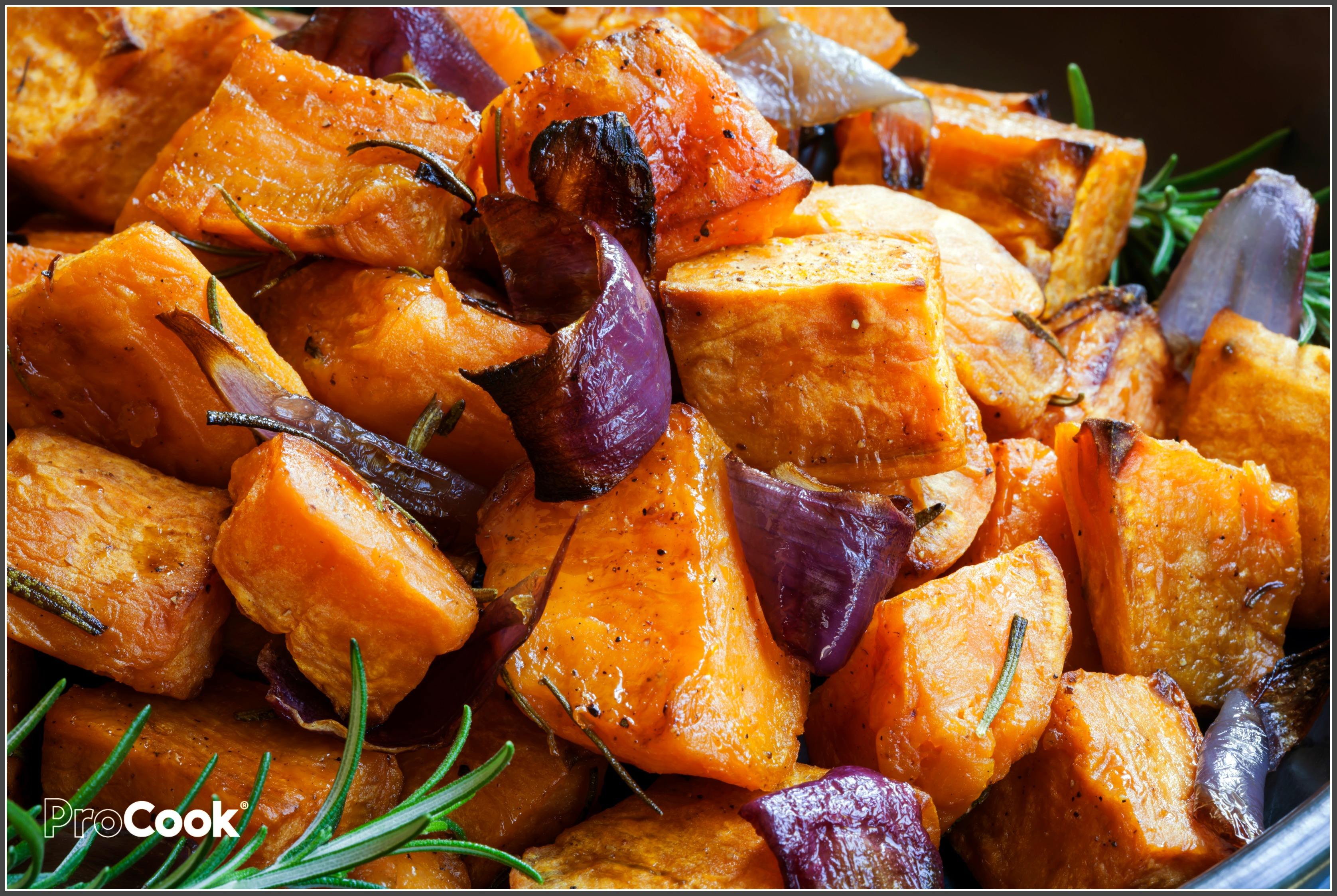 Sweet potatoes baked with red onions and rosemary.