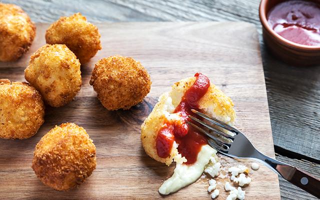 Arincini (Mozzarella stuffed risotto balls)