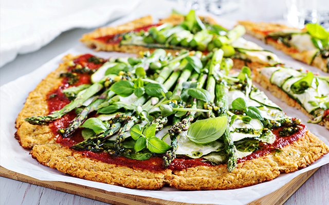 Cauliflower pizza with spring greens & pesto
