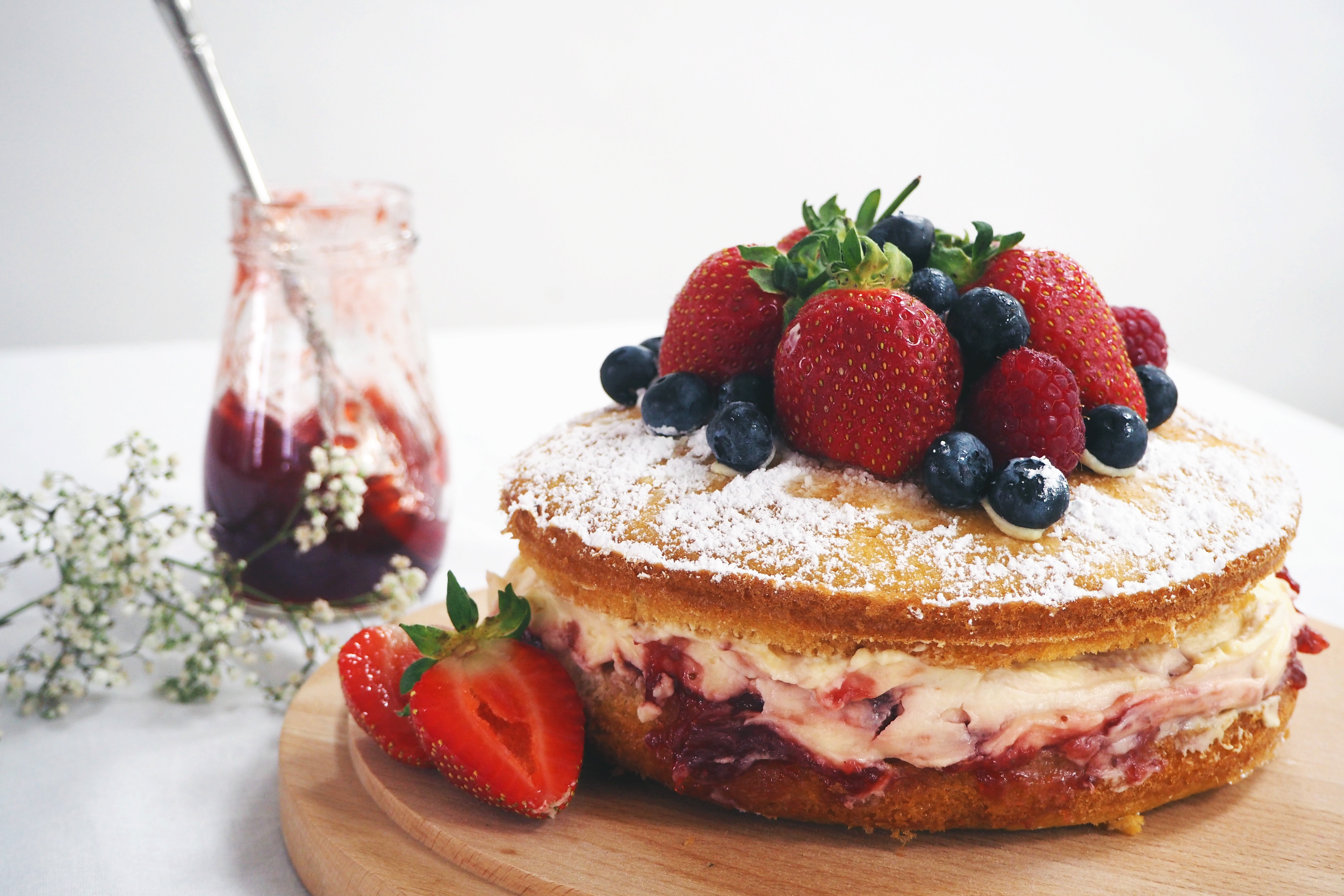 How to make a British staple, the classic Victoria Sponge cake topped with fresh berries and icing sugar