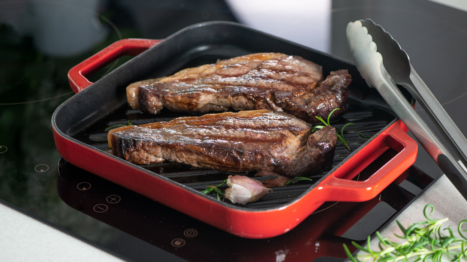 Sirloin steak cooking on a ProCook Red Cast Iron Griddle