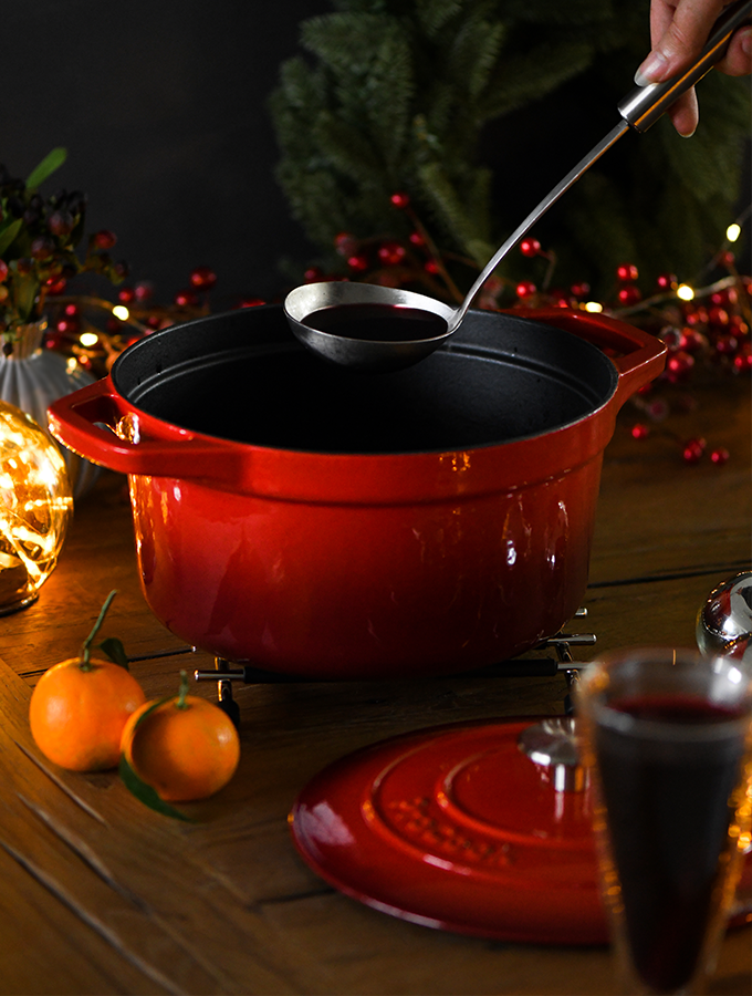 Mulled wine being served from a ProCook Cast Iron Casserole Dish in graduated red