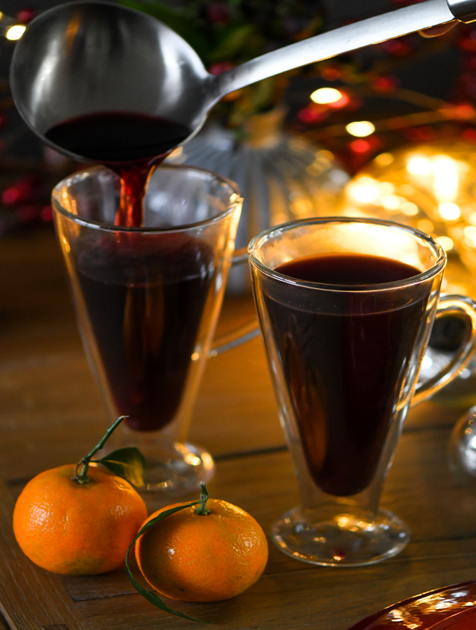 Mulled wine being poured into 2 ProCook Double Walled Latte Glasses