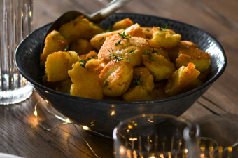 Roast potatoes served in a ProCook Malmo Serving Bowl in Charcoal