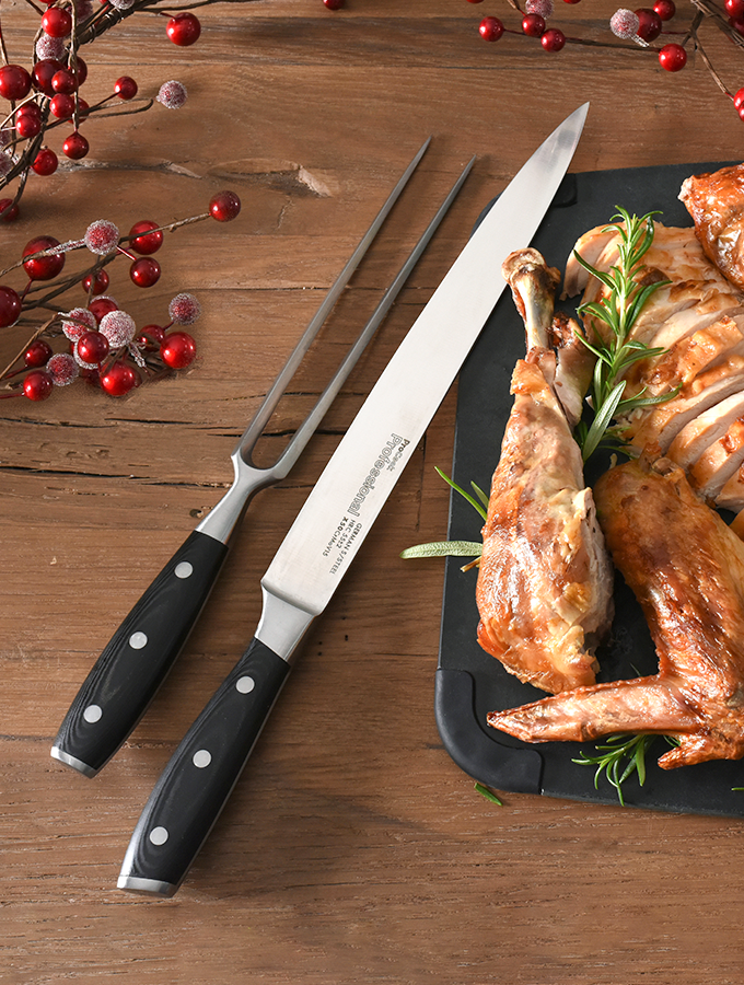 ProCook Carving Set next to carved chicken