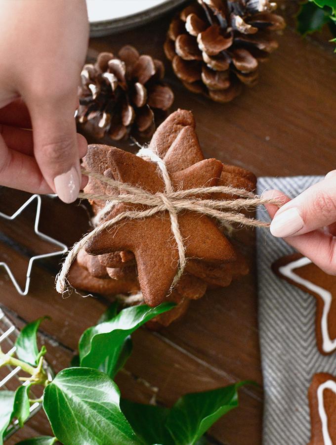 Tying string around Christmas cookies