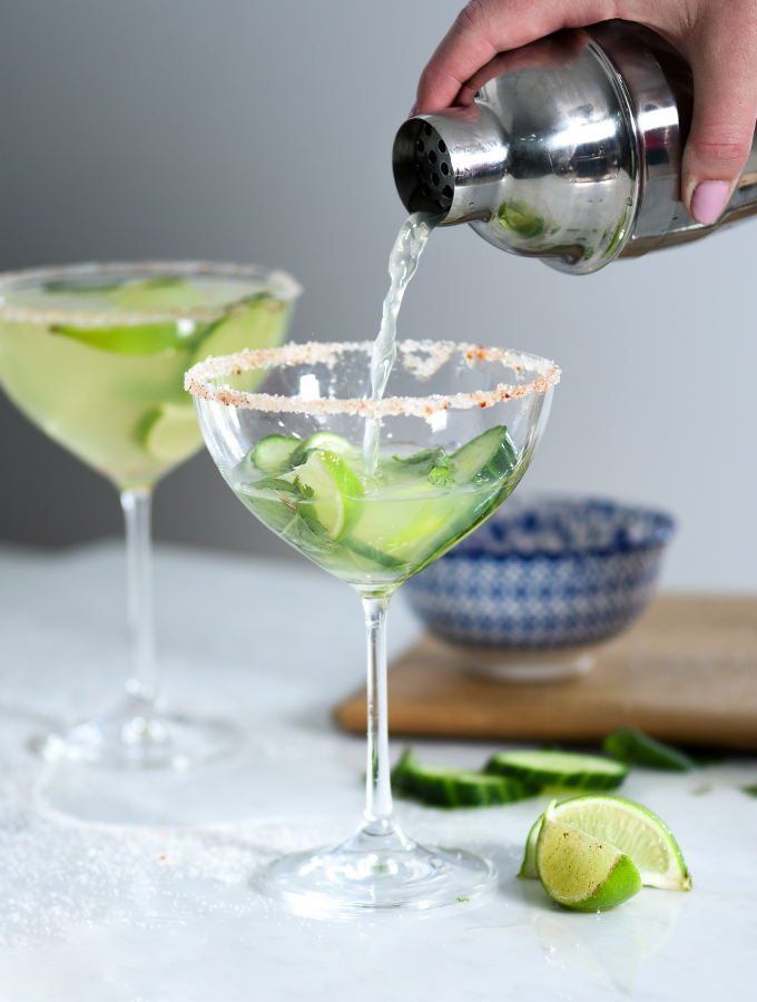 Pouring ProCook Cucumber Margarita into champagne saucer