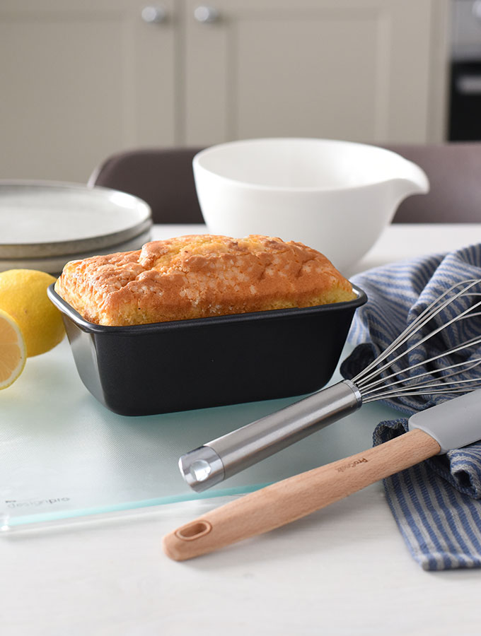 Everything for simple bakes surrounding a lemon drizzle cake baked in a ProCook loaf tin