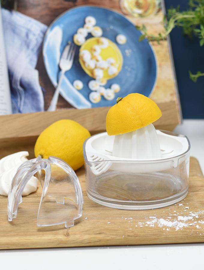 Half a lemon being juiced on ProCook lemon reamer