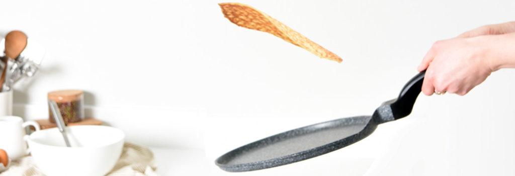 Flipping pancake in ProCook Crepe Pan for Pancake Day
