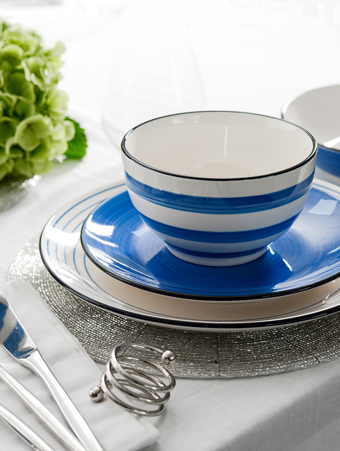 ProCook Coastal blue tableware stack at the table