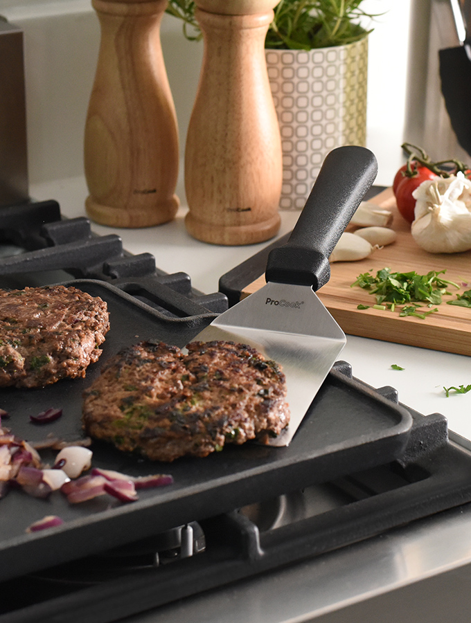 ProCook Grilling Spatula turning burger on a griddle