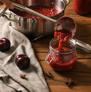 Pouring Spiced Apple and Plum Chutney into ProCook Preserving Jar